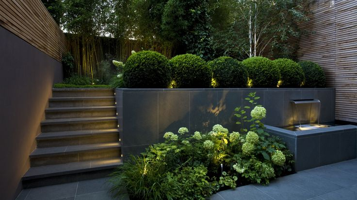 layered garden design with up lighting  | adamchristopherdesign.co.uk