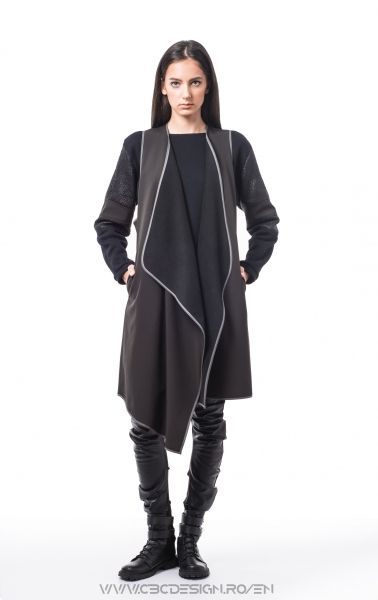 Oversized asymmetrical vest with side pockets from black softshell fabric, that is warm-keeeper and waterproof. Being a versatile item, it's loose fit allows it to be worn in multiple outfits through styling, either over tops or under jackets. It's neutral color transforms the Chalkboard Vest into a must-have item for layering.