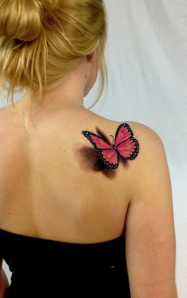 butterfly tattoo on back shoulder....OMG that is gorgeous! I'm not into butterflies but this is one awesome tattoo!!!