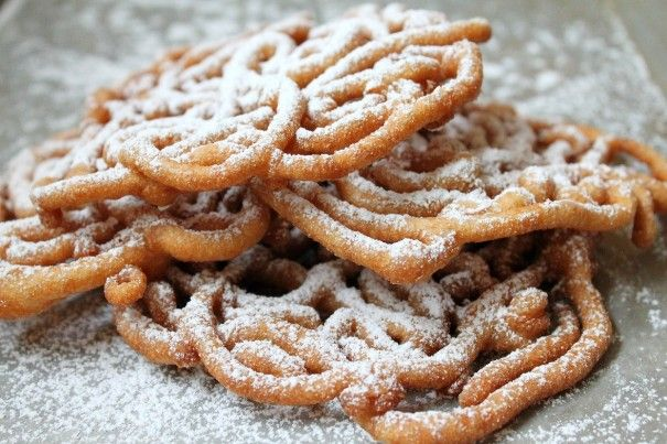 Easy Homemade Funnel Cakes - fast and easy made with pancake mix (really! Not that they are hard to make normally but with the mix you can make as many or as FEW as you want!)