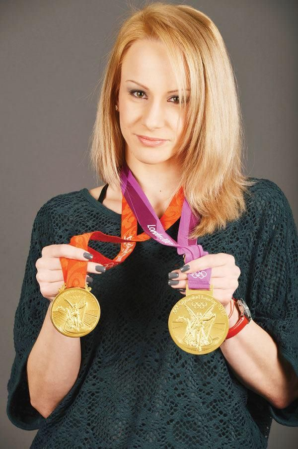 Sandra Izbasa with her Beijing 2008 floor gold and London 2012 vault gold (:
