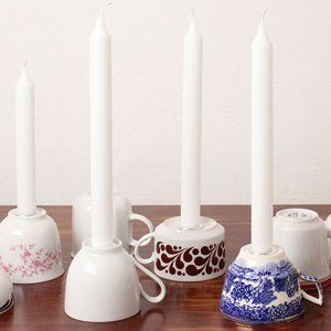 Tea cups as taper candle holders for tablescape.