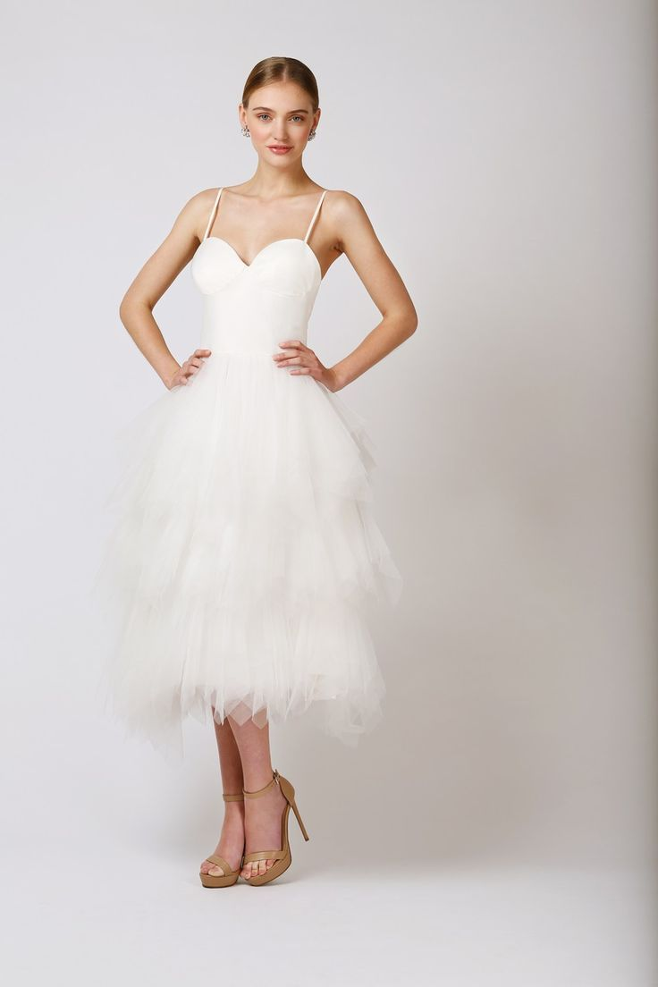 Inspired by the classic tutu, the Love Found True Lilly RuffleDress is a look designed for theplayful bride seeking a tea length dress withthat little touch of volume on her special day. Thin si...