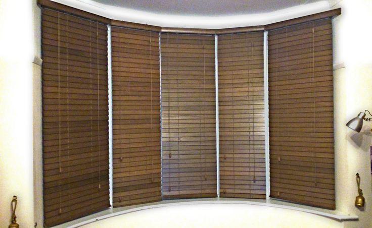 Dark oak wooden venetian blinds in five window bay http://www.pandablinds.co.uk/Southport_blinds.html