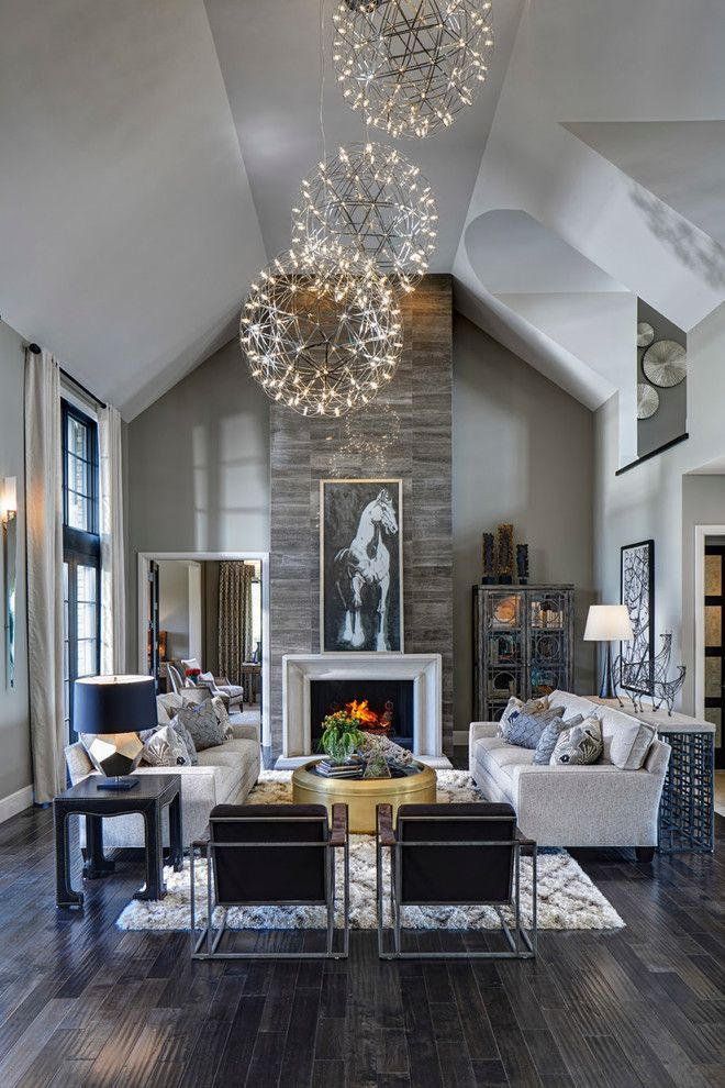Light Contemporary Great Room Living With Dark Rustic Wood Floors Stone Fireplace And Orb Chandeliers