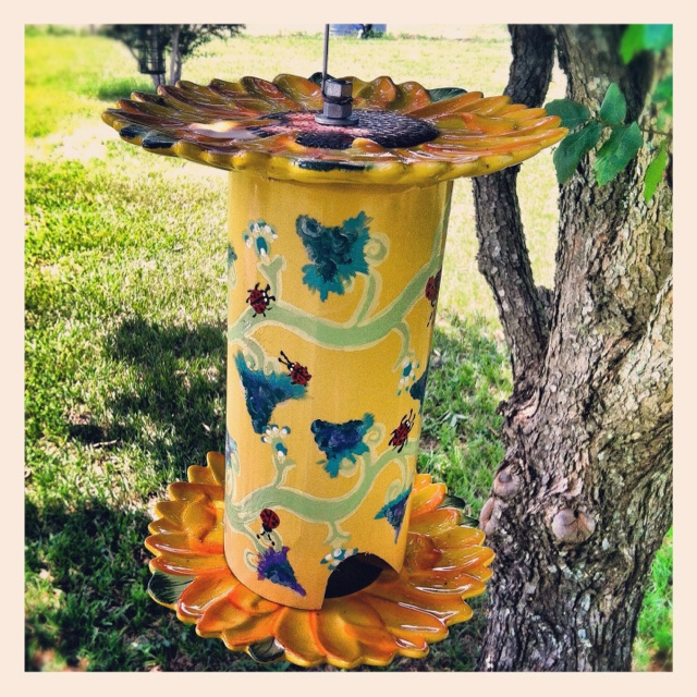 Hand crafted out of ceramic plates and PVC pipe: My first bird feeder!