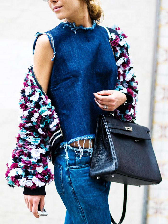 Dress up a denim-on-denim look with a frilly feminine jacket and structured purse