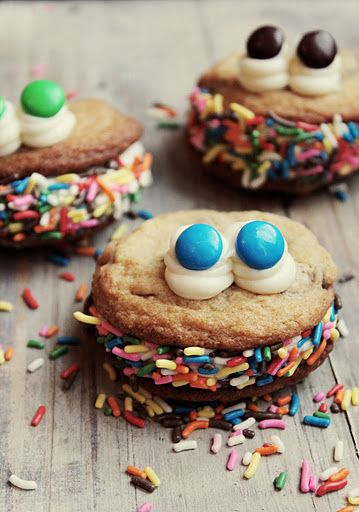 Monster Bash cookies... fill one side of your cookie with frosting, set your other cookie on top, press the back slightly harder to create an open mouth look, cover the frosting with your sprinkles and add a swirl of frosting to create two eyes and one for a nose, Simply press two M&Ms into the swirled frosting to create an eye color and you are done!! So much fun to do with the kiddos