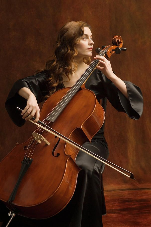 Young Woman Playing Cello by Pm Images