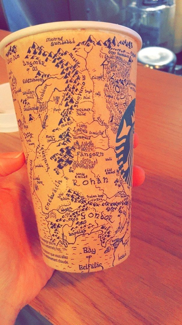 A Starbucks barista recently posted a photo of a coffee cup on Imgur featuring an incredibly detailed drawing of Middle-Earth, J. R. R. Tolkien's fictional continent where The Hobbit and The Lord of the Rings take place. The cup was given to the barista by Liam Kenny, a 26-year-old artist from Liverpool who created this extraordinary sketch in five hours. - Found via Buzzfeed