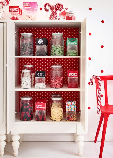 Retail display ideas from Ikea.  Glass jars filled with candy displayed in ISALA white cabinet