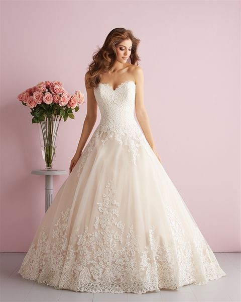 Style: 2701 On this strapless ballgown, dreamy English net is covered with climbing floral lace appliqué and finished with a demure sweetheart neck. Colors: 	White, Ivory, Champagne/Ivory Sizes: 	2 - 32 Fabric: 	Lace Appliqué and English Net