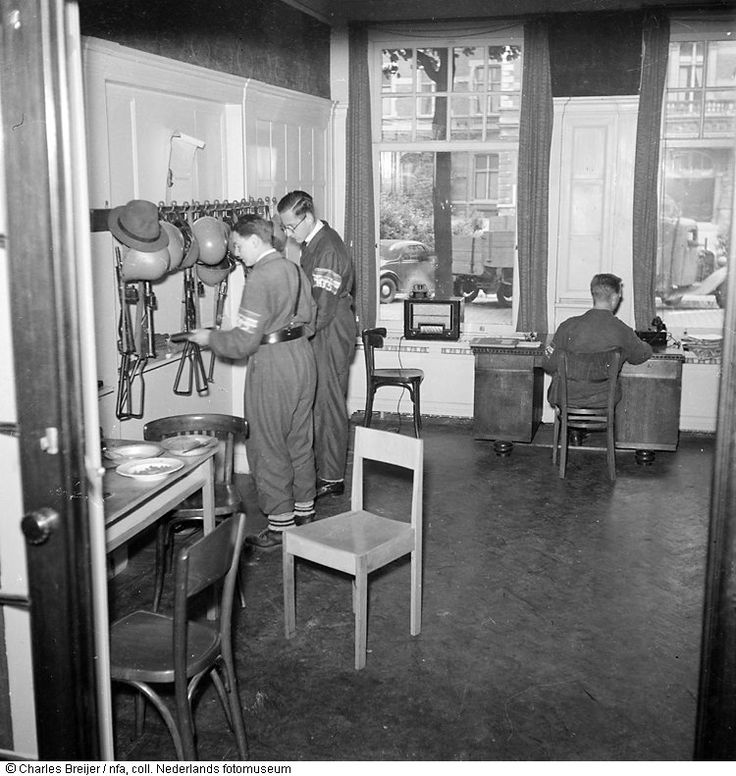 May 1945. Command post of the BS (Binnenlandse Strijdkrachten) in Amsterdam. The BS was officially established on September 5, 1944 when three resistance organizations – the OD, LKP and the RVV – decided to coordinate their resource and action plans under a central command. Photo Nederlands Fotomuseum / Charles Breijer. #amsterdam #worldwar2 #nbs #bs