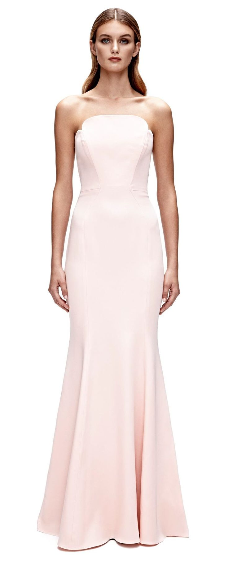 Jill Jill Stuart Pink Gown A dramatic hourglass strapless gown with artfully sculpted neckline and seaming detail. Boning all around. Silicone gel elastic on inside top edge. Center back metal zipper with hook and eye on top.