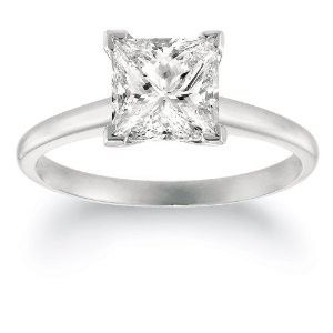 one simple princess cut on a white gold band literally will say it all. simply stunning