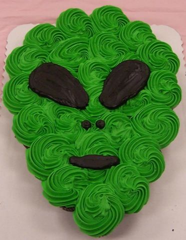 Alien Cupcakes- jays birthday cake. I know hes an adult but hes obsessed with aliens