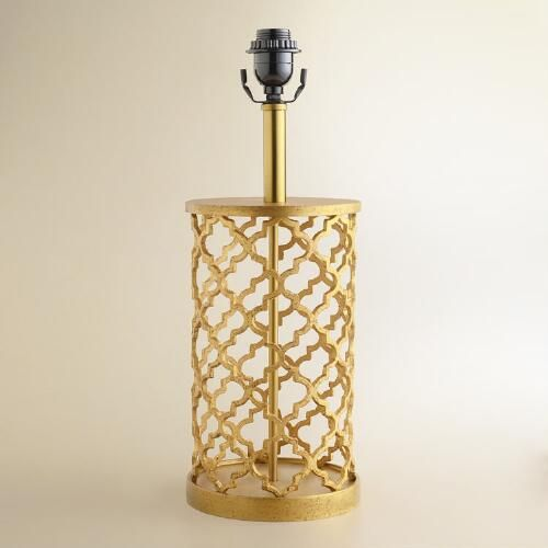 Brighten any nightstand, side table or desktop with the exotic appeal of our exclusive Distressed Gold Moroccan Table Lamp Base. Crafted by artisan...