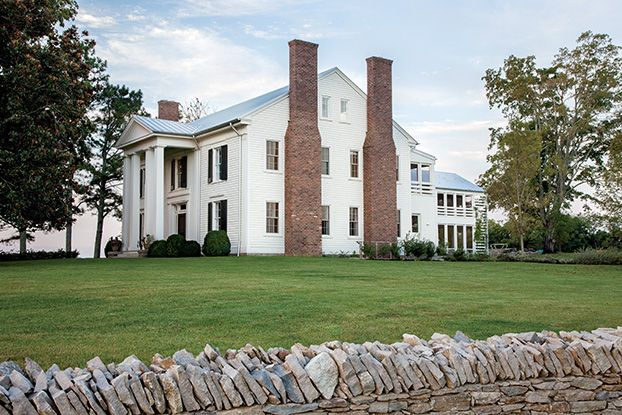 Photo Credit: Caroline Allison. A walk around the side of the 1855 Greek Revival home reveals an unexpectedly modern addition out back.
