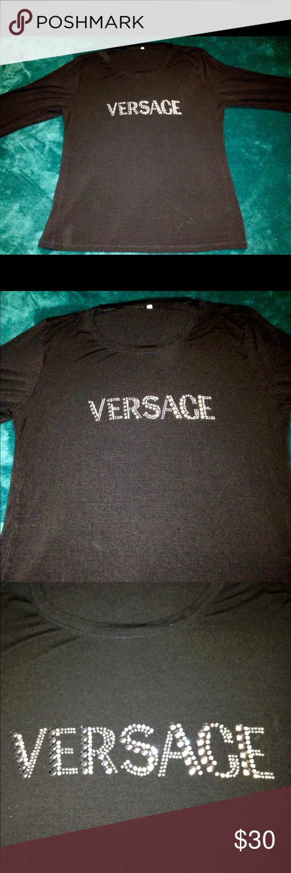 "Ladies Versace 3/4 length Shirt Bling Sz 4 M Ladies Versace 3/4 length Shirt Bling Sz 4 M in great preowned condition. Stretchy fabric in black with bling spellout- Versace. Size 4 or ladies medium. Armpit to armpit 18"" Versace Tops"