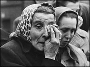 A woman weeps as she watches Russian military action against the Hungarian anticommunist uprising of 1956
