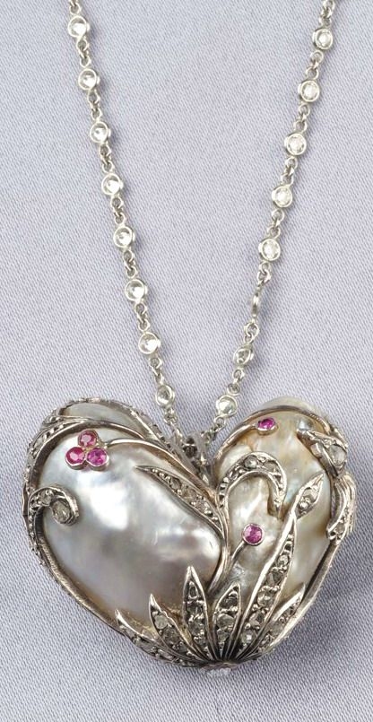 Natural Baroque Pearl Pendant, the #heart-shaped cream and light grey baroque pearl measuring approx. 29.98 x 17.05 mm, with silver, rose-cut diamond, and ruby melee foliate mount, suspended from platinum and spectacle-set diamond chain, lg. 21 in.