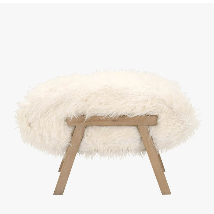 Our Luxe Faux Sheepskin Ottoman Stoolwill add a global vibe to any decor. Perfect as a footstool or additional seating for small spaces.
