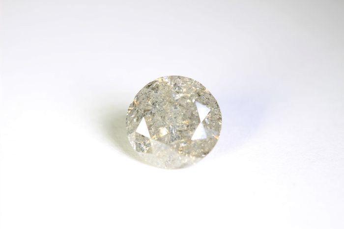 1.42 ct diamond.  Afmetingen: 721-732 x 4.34 mm.Duidelijkheid: I3.Behandeling:Behandeling: geen.Totaal gewicht in karaat:. 1.42 ct.Diamant kleur:. Ik.Vorm:Ronde BrilliantGesneden rang: uitstekend.Pools:Heel goedFluorescentie:geenCertificerende laboratorium:.AIG laboratoria.AIG nummer:. AIG D-84185768BE.Foto's werden geschoten met een macro lens en geschikte verlichting.Dit werd gedaan om eerlijk en duidelijk tonen de onvolkomenheden van de steen.Het komt in:AIG certificaat.Deze diamant is…