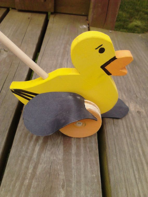 Old Fashion Wooden DUCK PUSH TOY (Flapper toys). $15.00, via Etsy.