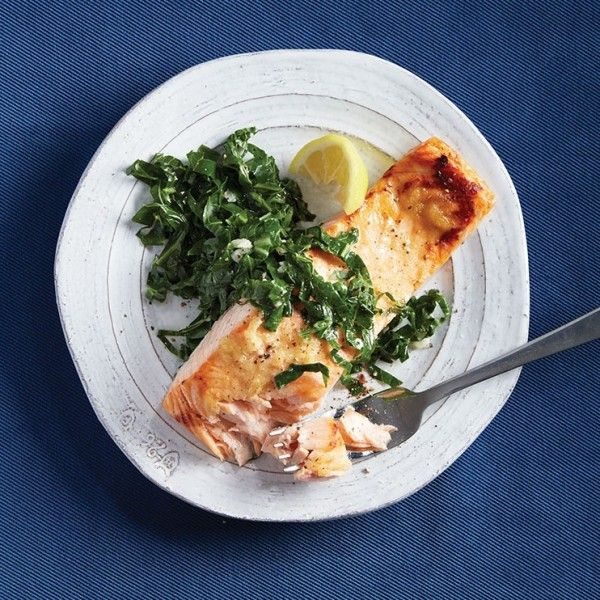 Give this sweet and spicy salmon, topped with garlicky collard greens a try tonight.
