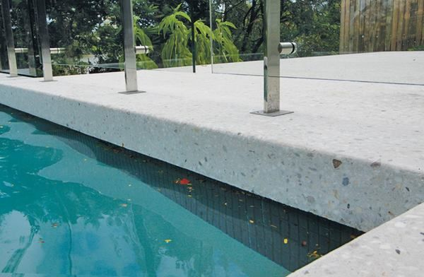 Many of the surfaces outside the home have polished concrete, including the pool surround.