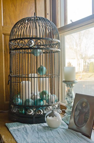 Try my mint green bird cage, fill with a white pillar candle (or tapers) and lots of vintage ornaments.