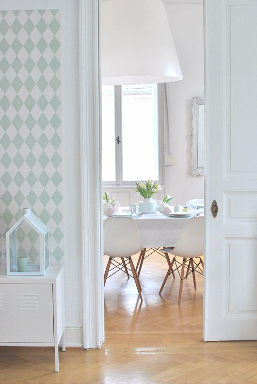 Green Ferm living Harlequin wallpaper in hallway. Good match with white dining area.
