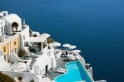 Katikies Hotel is perched on the cliffs of Oia, Santorini, 300 meters above the blue waters of the Aegean Sea, the resort offers a restaurant has a...