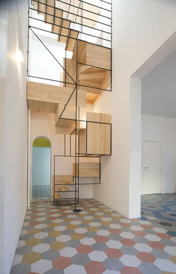 Mind-blowing staircase designed by Francesco Librizzi's studio. It's made from a geometric metal structure that supports various wooden components that become stairs you can climb.