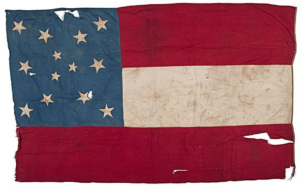 Confederate First National Battle Flag captured by John A. Landis, who commanded the 1st Iowa Cavalry battalion, never submitted a formal report and the regiment received no accolades for the action known alternatively as Black Water or Milford.   John A. Landis (1835-1915) was born in Xenia, Ohio and was living in Martinsburg, Iowa when he enlisted in Company I., 1st Iowa Cavalry on June 13, 1861. Landis was soon transferred to the field and staff as regimental Quartermaster on Oct. 7.