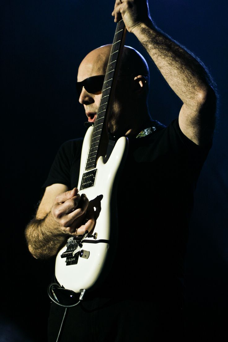 Joe Satriani. Definitely a guitar hero. He taught the god of guitar (steve vai) how to play. He's awesome though. Always loved his work.