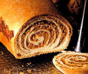 Slovenian miners who settled in the upper midwest introduced this sweet yeast bread to American cuisine. The dough is rolled very thin to make many layers of nut filling.