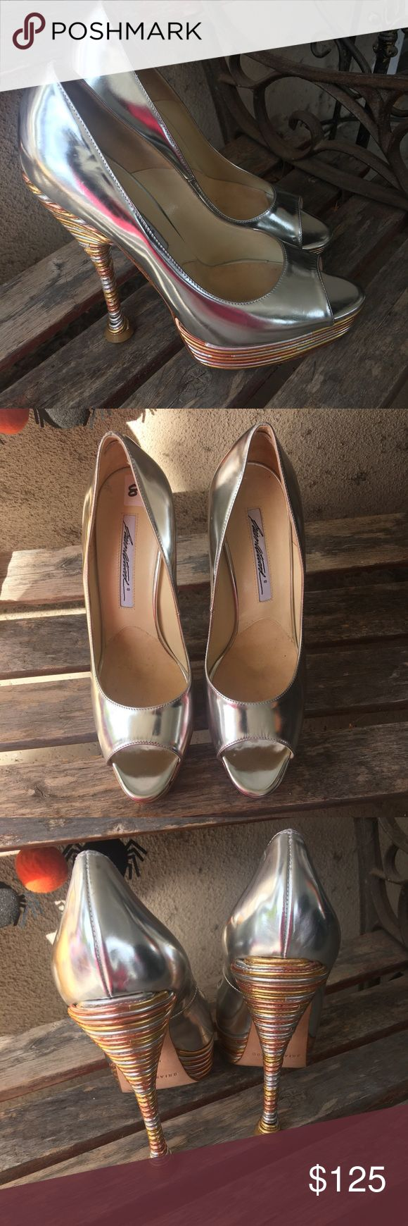 "Brian Atwood silver peep toe heels size 38 Brian Atwood silver peep toe heels size 38. Heel is 6"". Multiple scuffs throughout shoes.  Not very noticeable because they are metallic. Leather soles made in Italy Brian Atwood Shoes Heels"