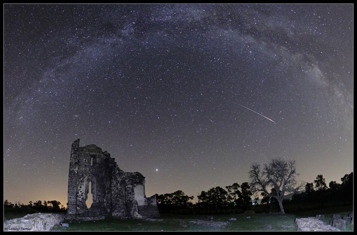 Before the Meteor Rush -  In the foreground stands the region's Church of St. Andrew ruin, with bright Jupiter dominating the sky to its right. Two galaxies lie in the background: our own Milky Way, and the faint smudge of the more distant Andromeda Galaxy just above the ruin's leftmost wall. Credit: Tamas Ladanyi (www.astrophoto.hu)