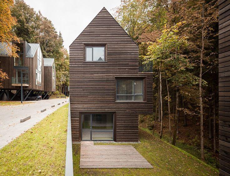 paleko + plazma nestles wooden housing development in a lithuanian nature reserve