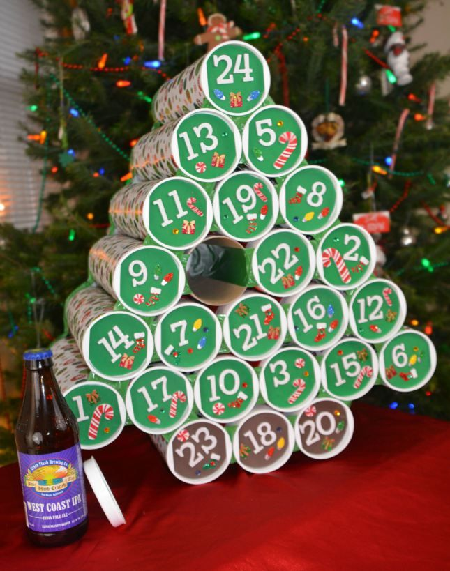 Beer Advent Calendar - Use recycled Pringles containers and construction paper then fill with tall boys and individual bottles of beer and cider!