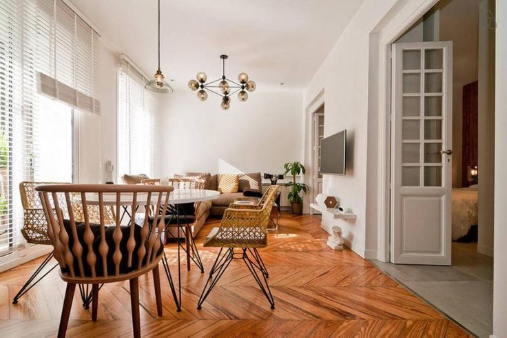 http://www.drissimm.com/wp-content/uploads/2014/12/elegant-wooden-parquet-floor-design-in-small-apartment-interior-with-small-pendant-lamp-above-white-round-dining-table-including-small-living-room-in-the-nearby.jpg