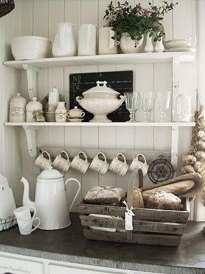 Art white kitchen storage wall :-) shelves, hooks, mugs, teapot, bread beach-cottage-kitchenalia