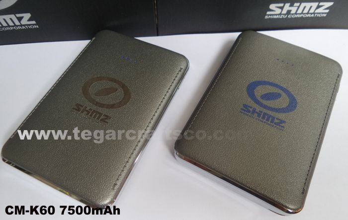 Powerbank CM-K60 kapasitas 7500mAh unit size 10.2 x 6.8 x 0.8cm, leather feel texture, power indicator, 2 USB outputs, USB Cable ordered by PT Shimizu Corporation Indonesia, Jakarta.