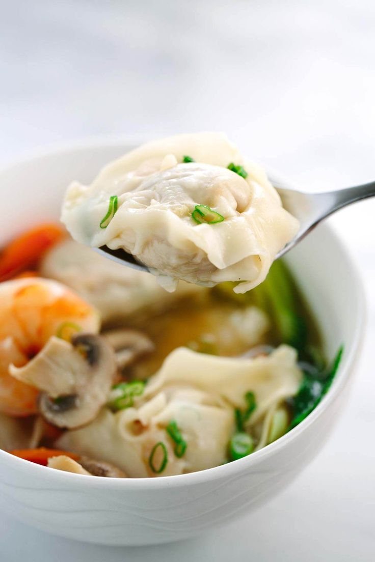 Easy Homemade Wonton Soup Recipe - Each hearty bowl is packed with plump pork dumplings, fresh vegetables and jumbo shrimp. This authentic Asian meal is fun to make!   jessicgavin.com