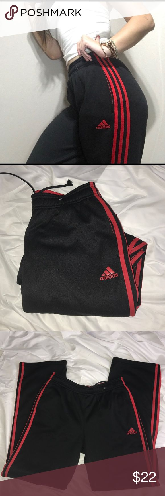 Adidas pants black and red Size xlarge boys fits a women's small Worn only once Super soft inside 3 stripes down both legs Pants Track Pants & Joggers