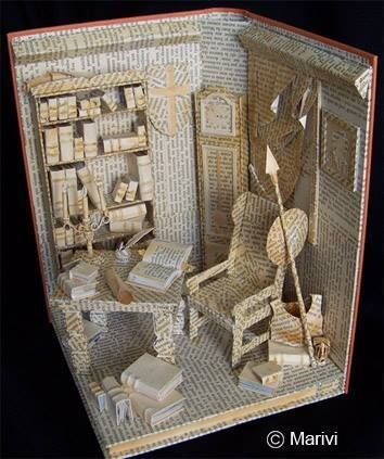 Book art! It's like a doll house made of the written word.