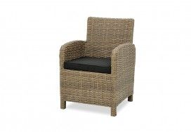 WICKER FURNITURE is often associated with a British Colonial/safari theme, and this comfy outdoor chair can serve double duty as a bedroom chair. Outdoor Chairs
