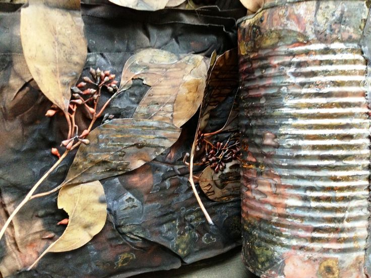 Tin can and eco print dyeing. Wrapped and steamed in a camellia flower bath for an hour, then left for a week before opening.