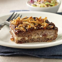 BBQ Bacon Meatloaf: Meatloaf with bacon, sweet hickory BBQ sauce and a surprise layer of cheese topped with crunchy fried onions